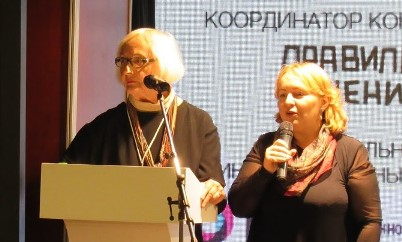 "Jan Hively, co-founder of the Pass It On Network, speaking about ""What's next for all of us?"" ""Changing Expectations for Aging."" Jan's spoken words were repeated in Russian by Nina Koryakina, a translator who teaches English as a Second Language."